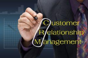 Businessman drawing circle on customer relationship management